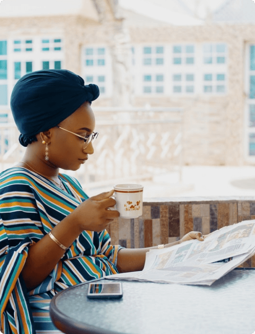 Image of a woman reading a newspaper